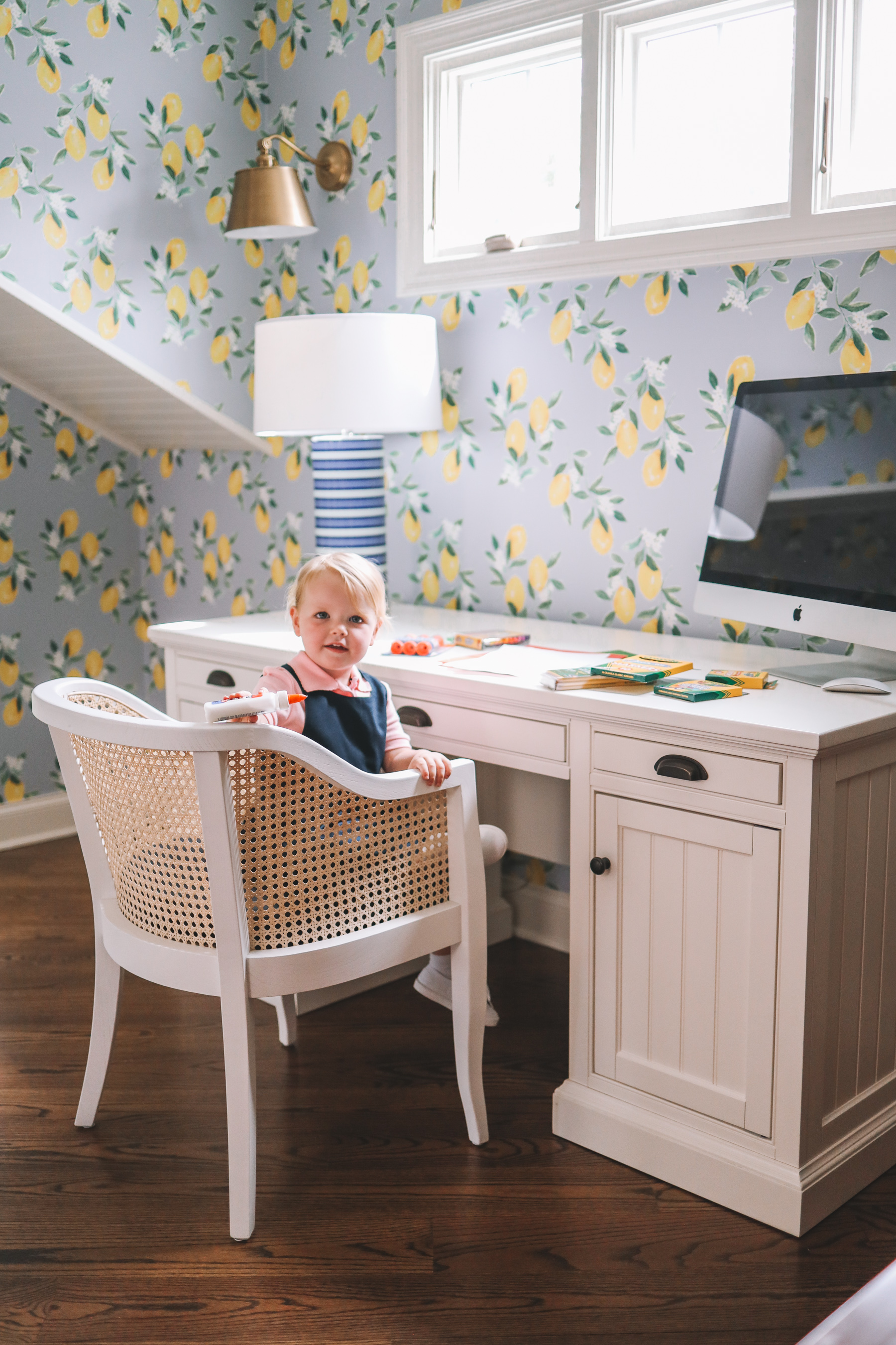 a little girl at a desk