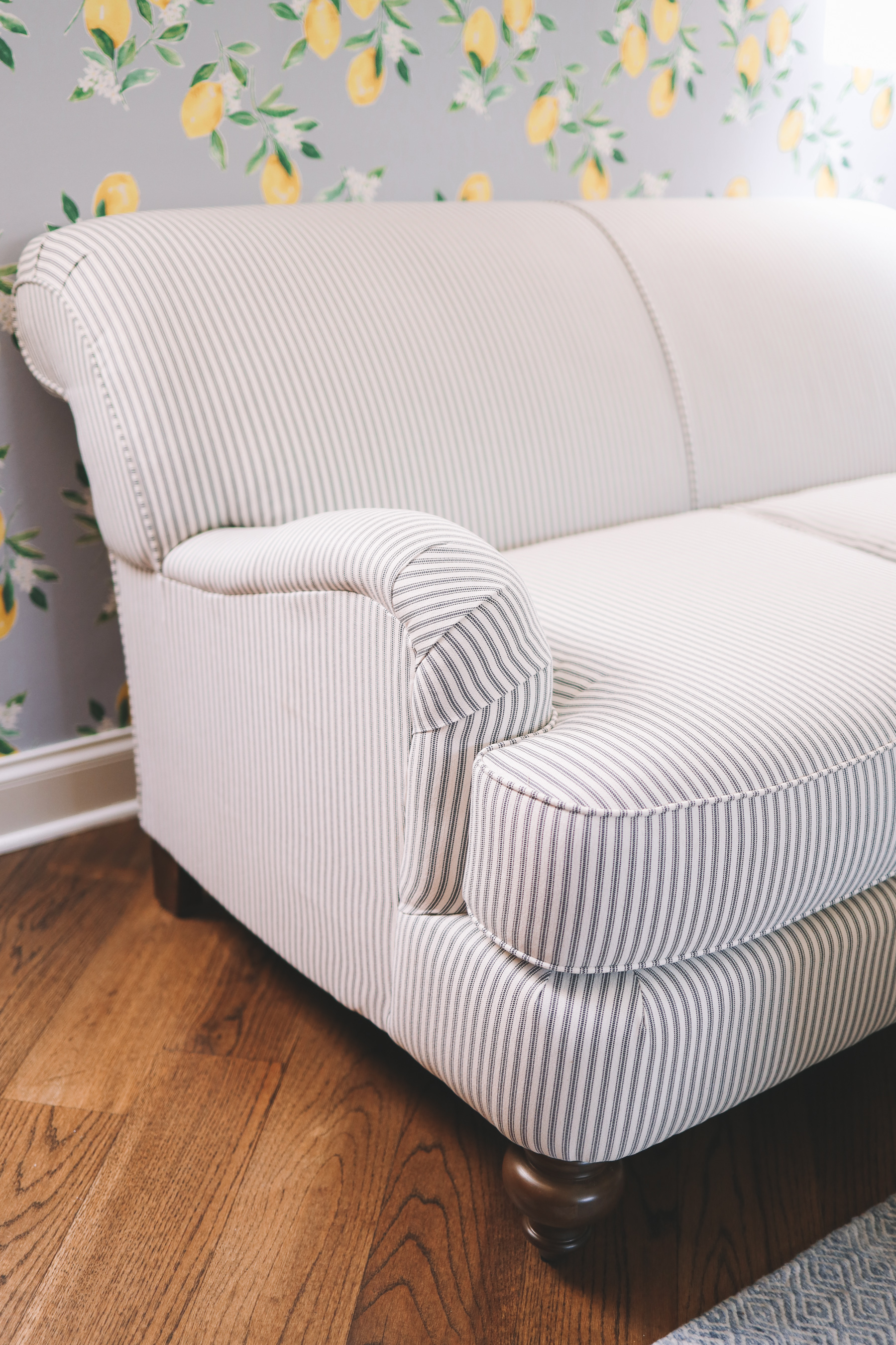 lemon wallpaper contrasting pinstripes on the loveseat