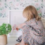 a little girl and floral home wall paper