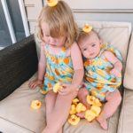 Lucy and Emma are covered in rubber duckies