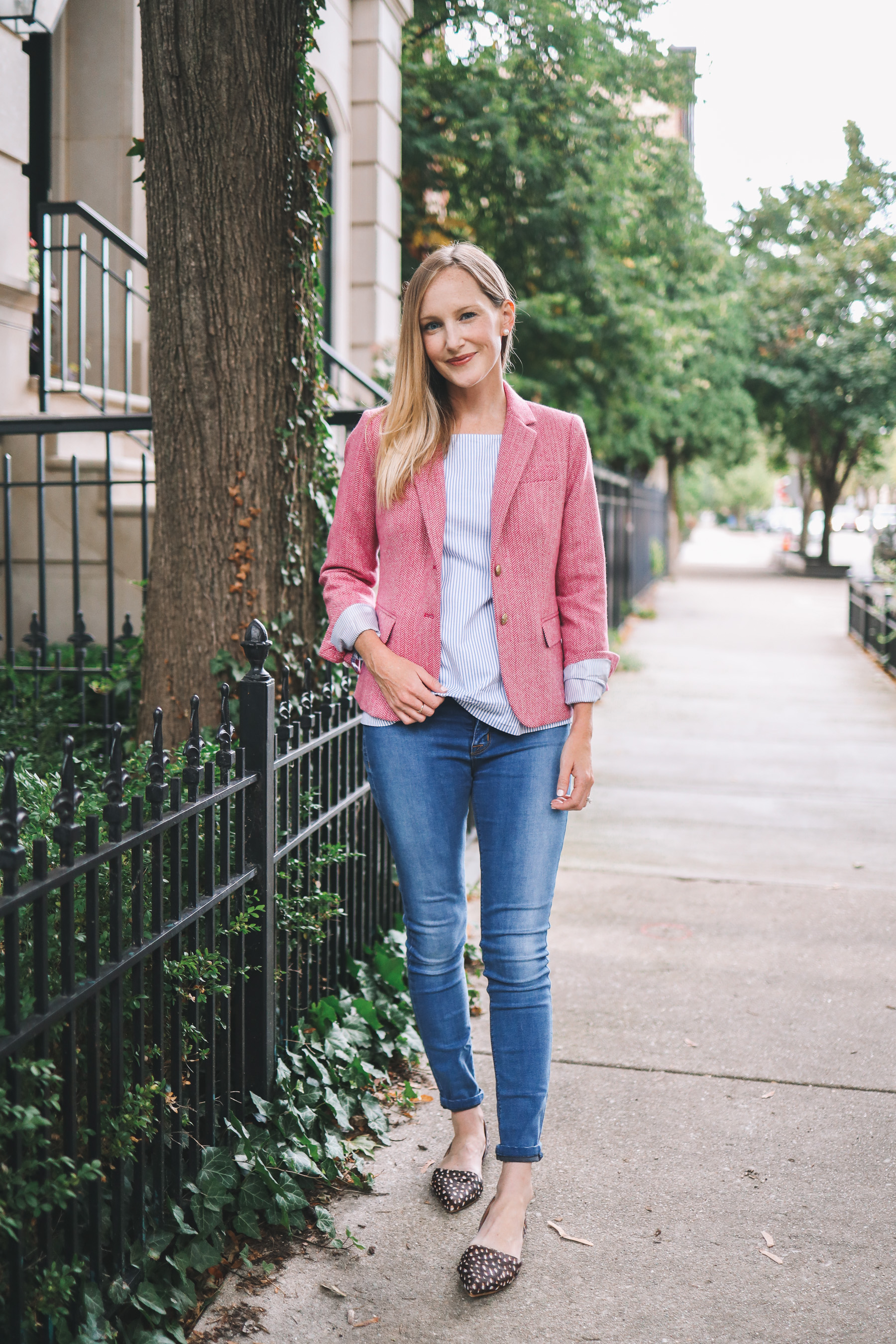a mom in a pink blazer