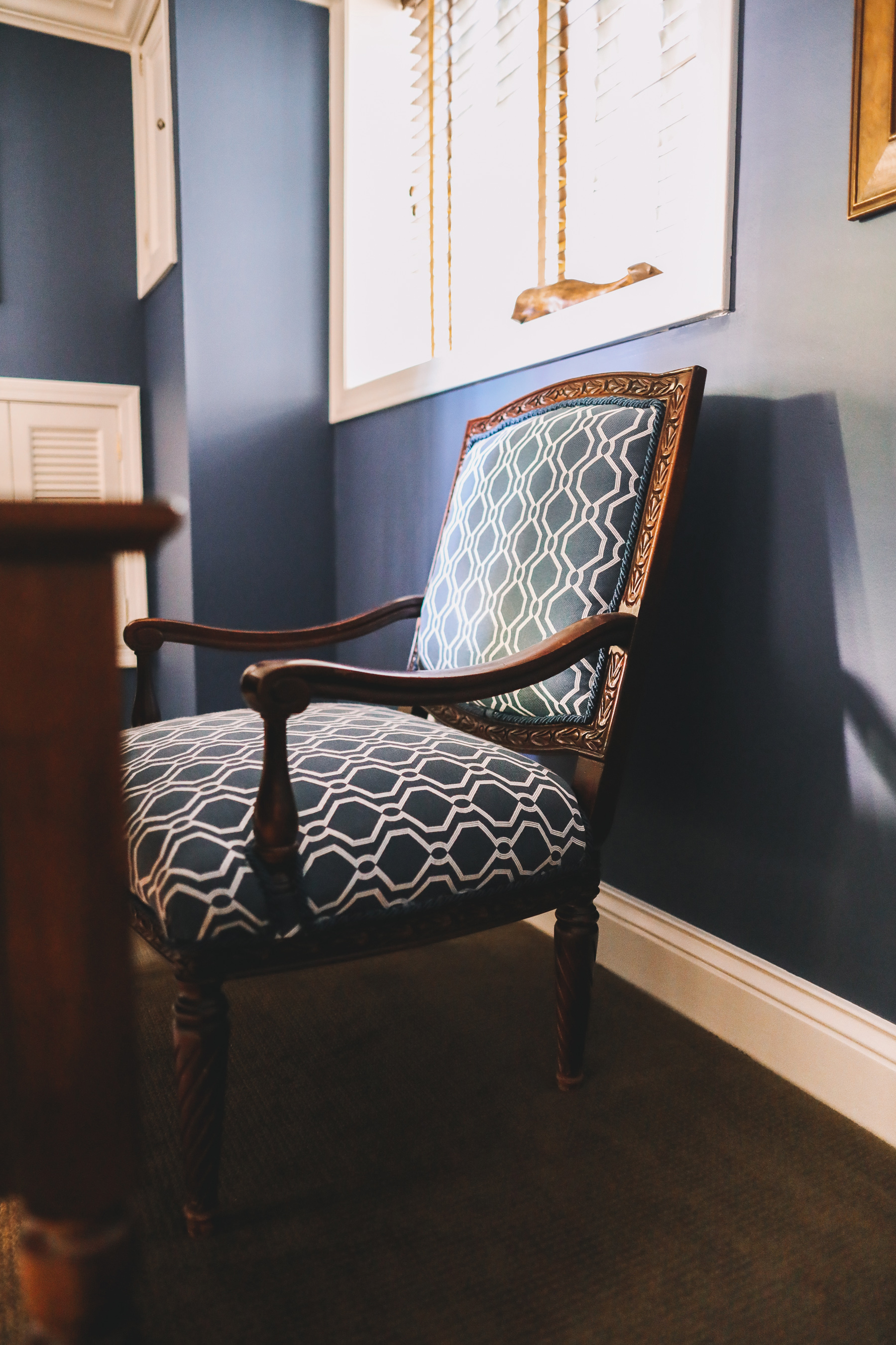 a blue chair in a study