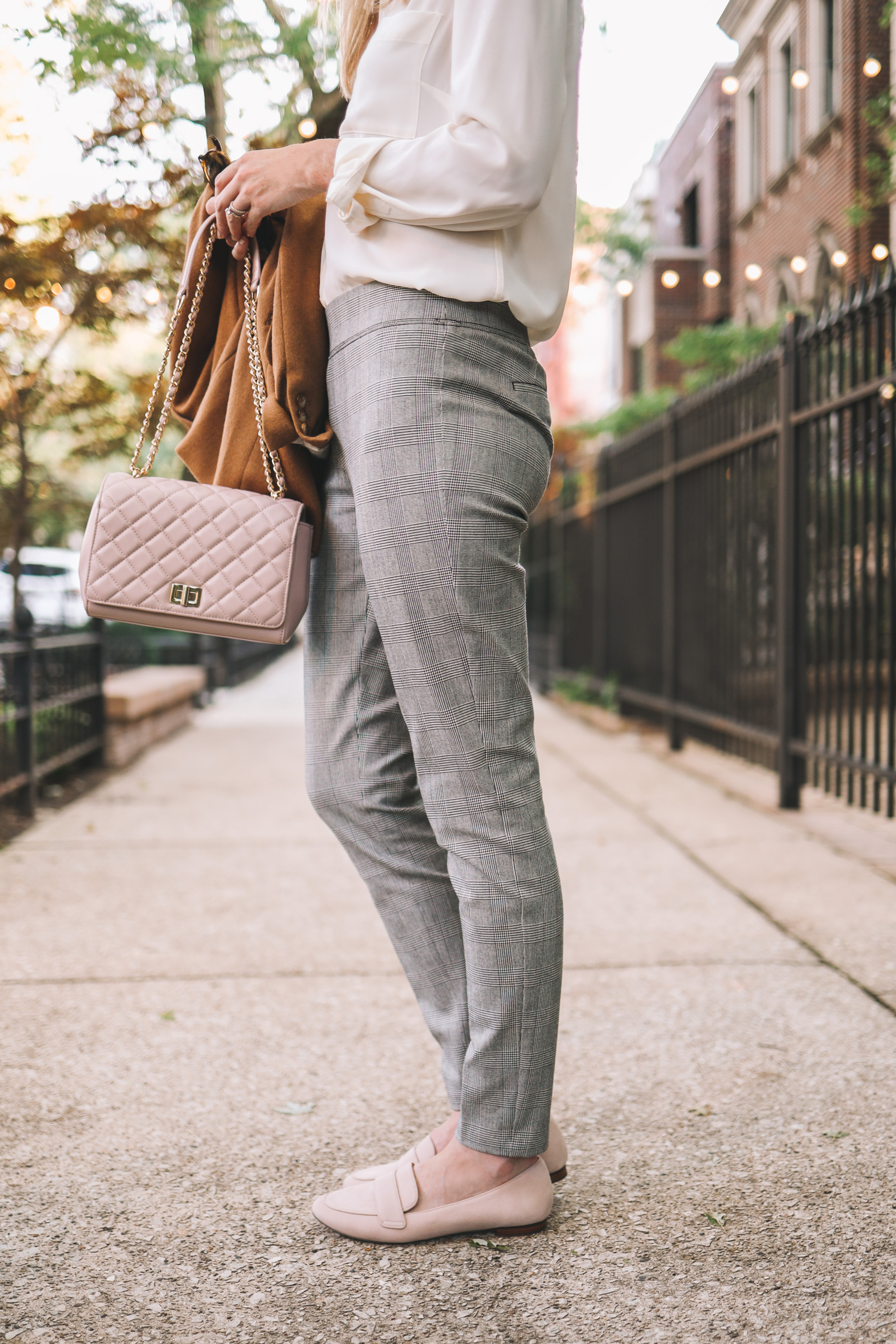 fall look of pants and a white shirt