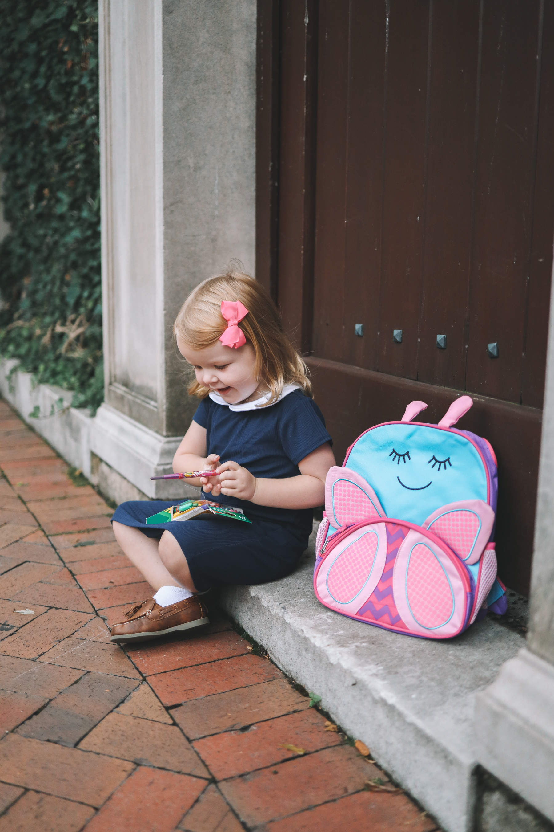 Navy Peter Pan Collar Dress and Toddler Butterfly Backpack