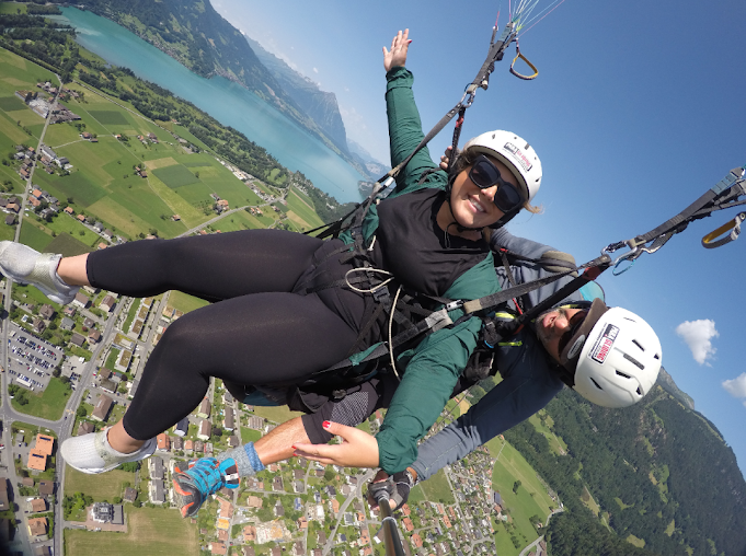 a woman who is paragliding