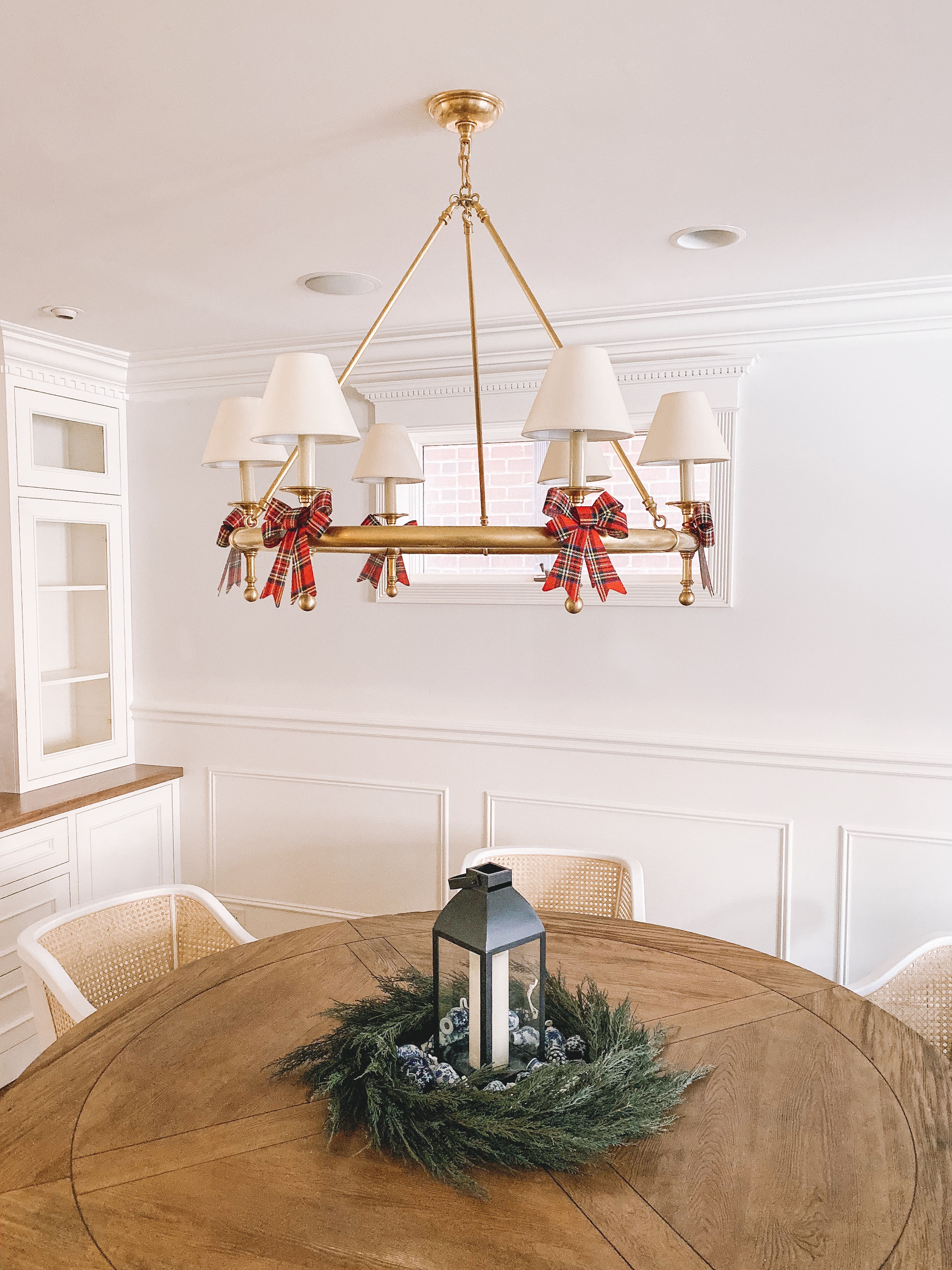 Our recent home purchases include a lantern, a wreath, and a chandelier.