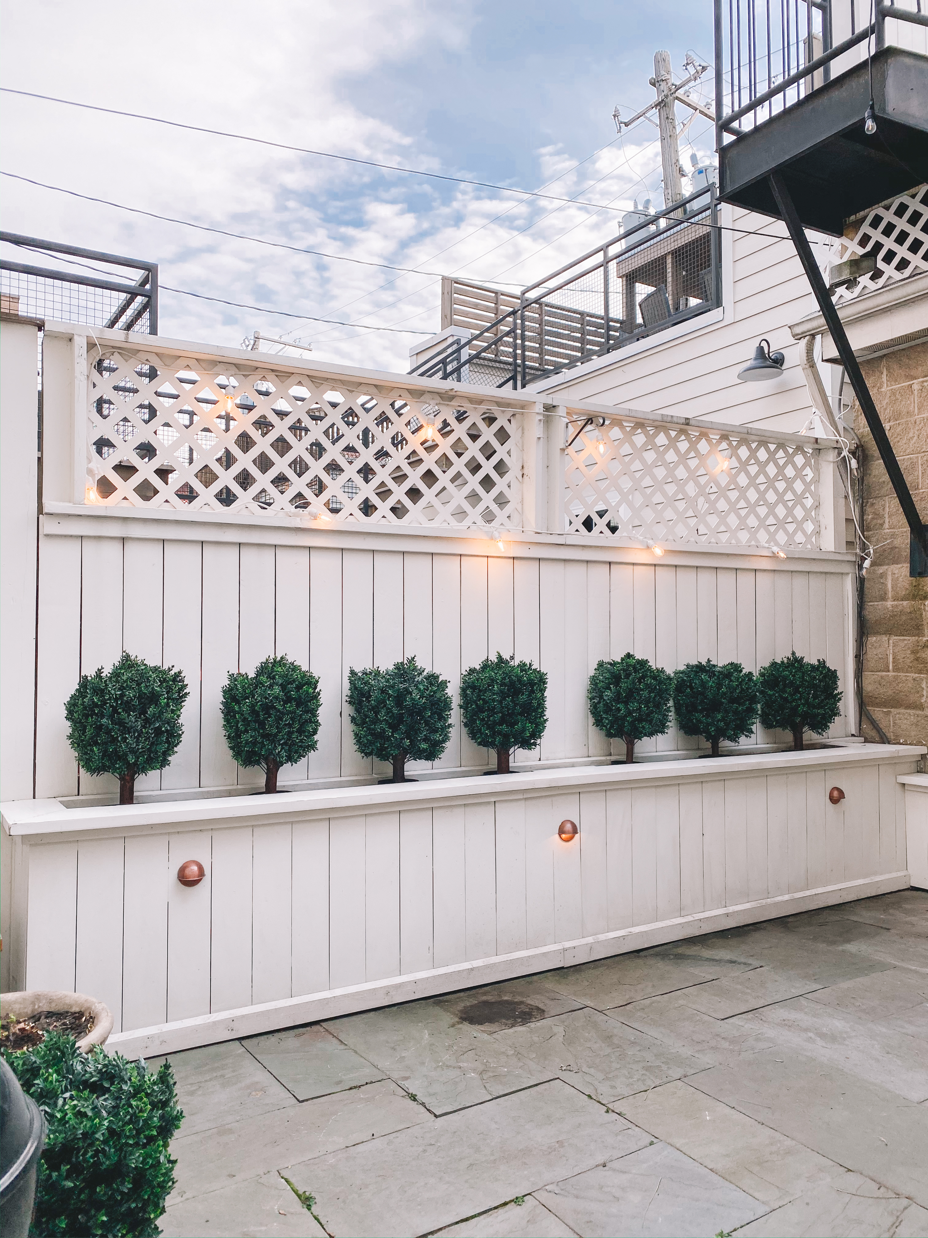 Patio With The Awesome Faux Boxwoods - Kelly in the City