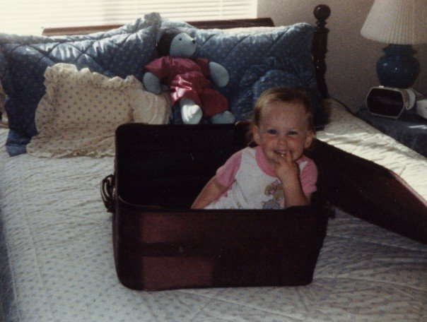 Me in a suitcase (?) on my parents' bed
