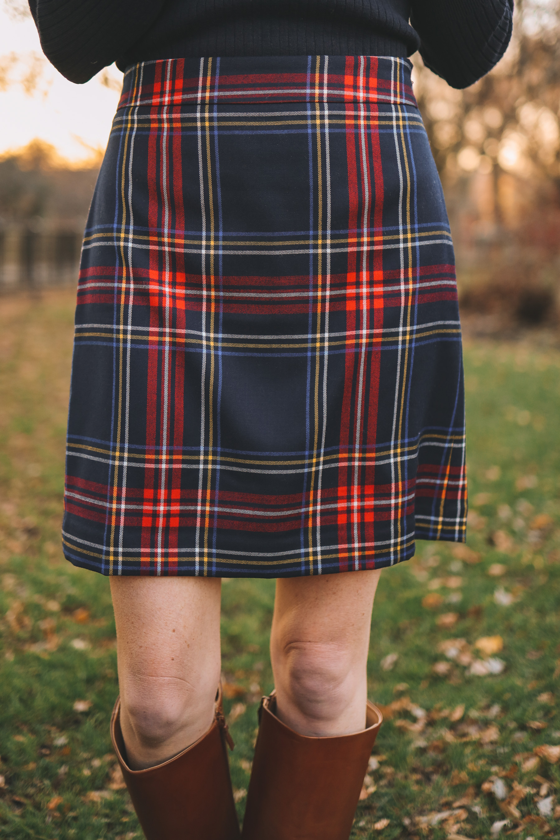 Tartan Skirt and Riding Boots