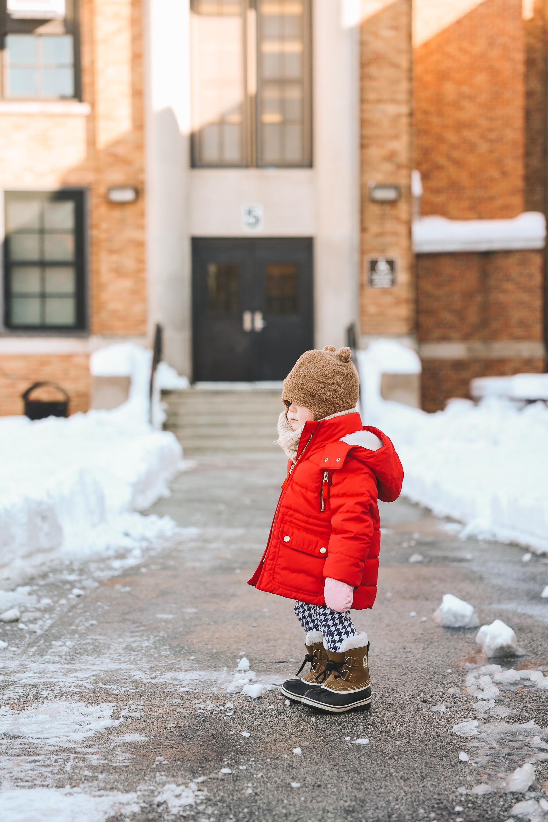Toddler wearing Sorels waterproof boots