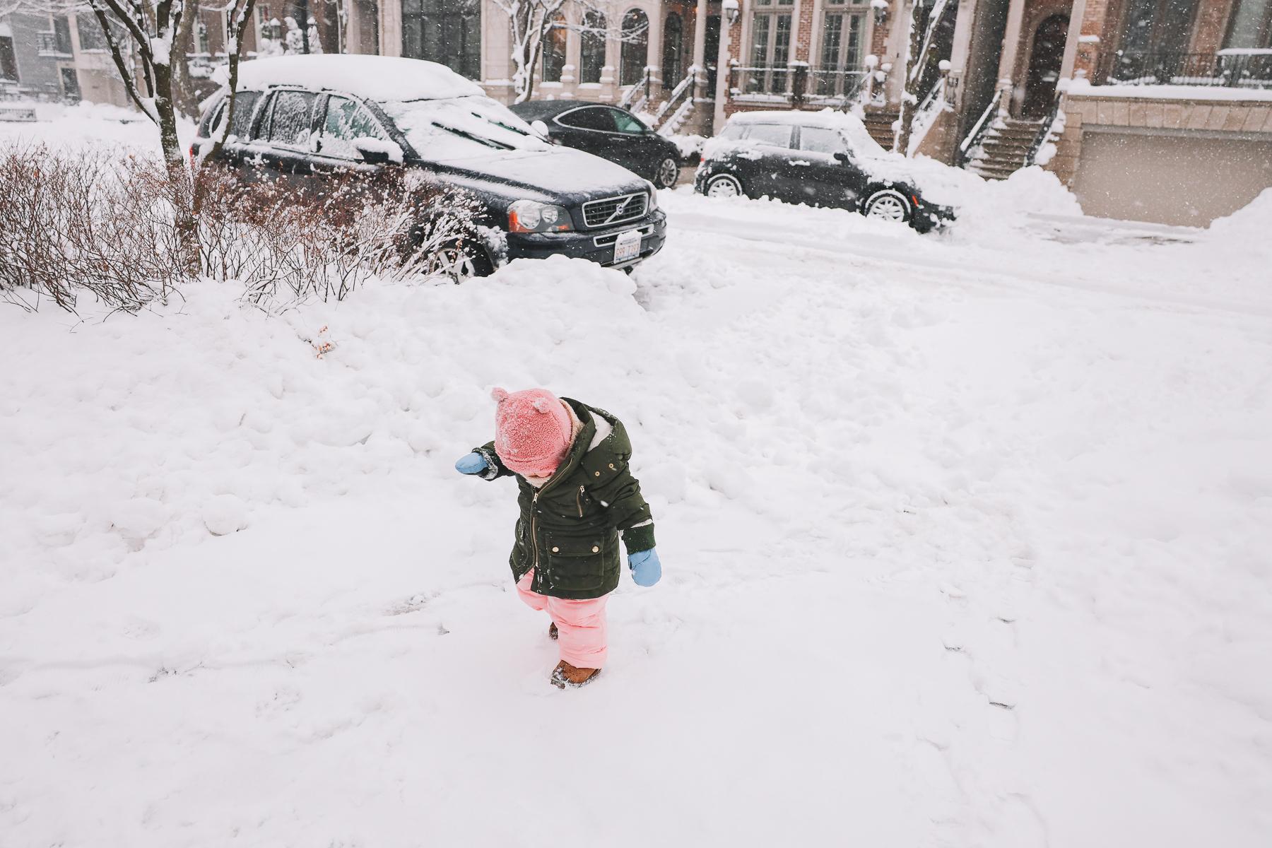 baby walking in snow