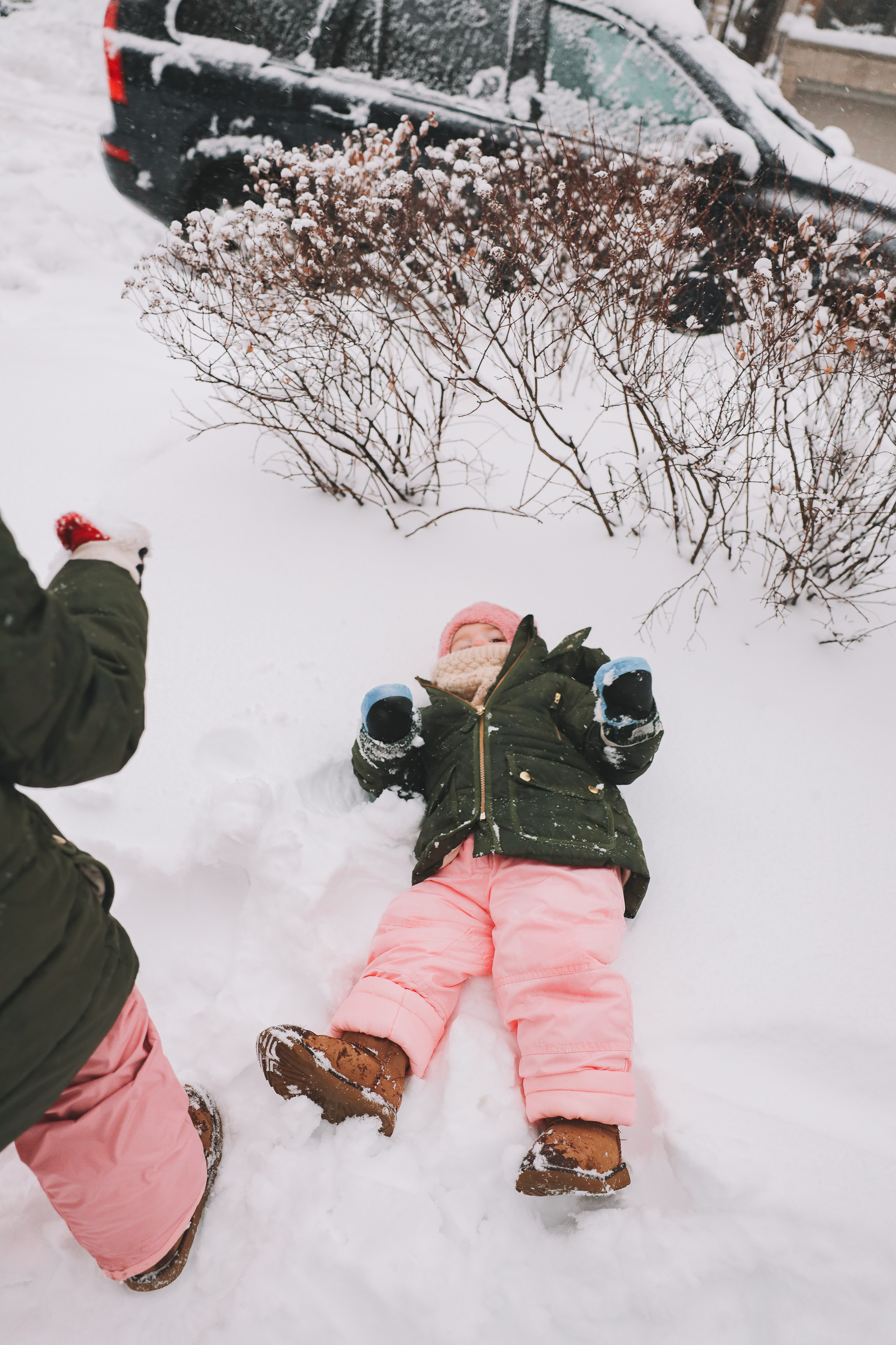 baby laying in snow