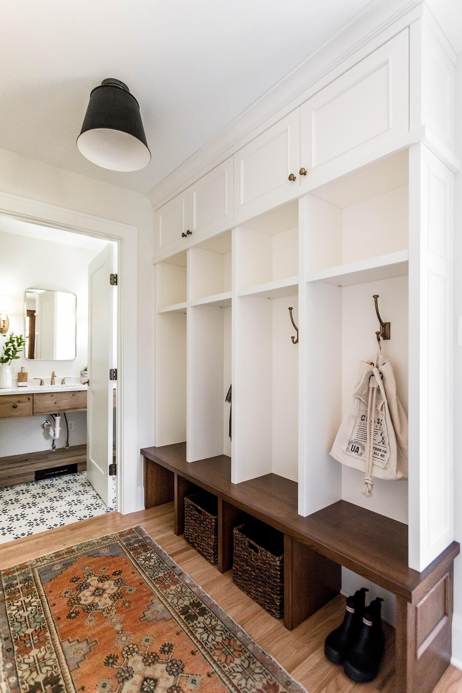 mudroom with hooks and bathroom