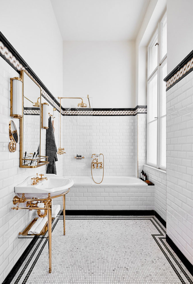 black white and brass bathroom