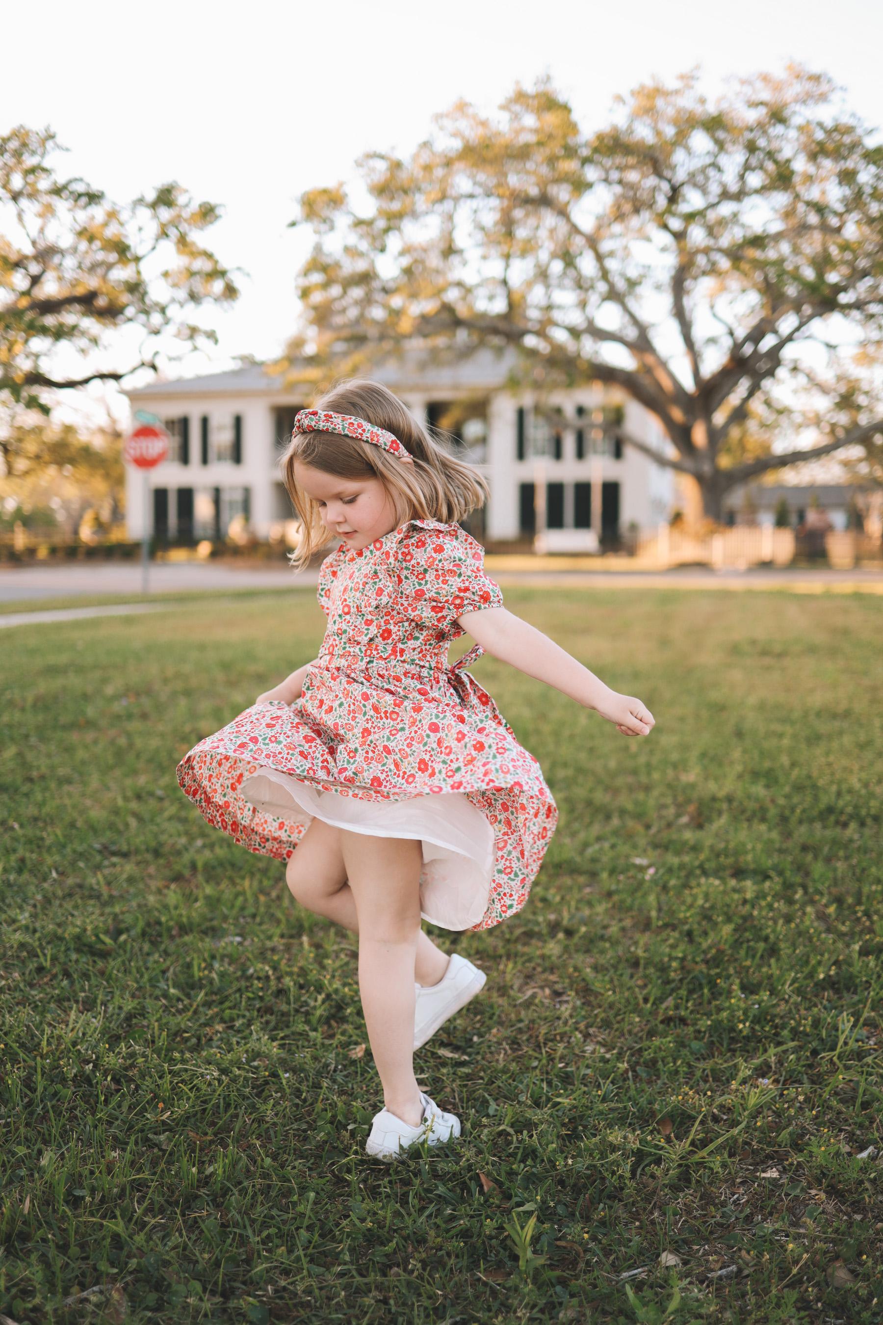 little girl twirling her dress