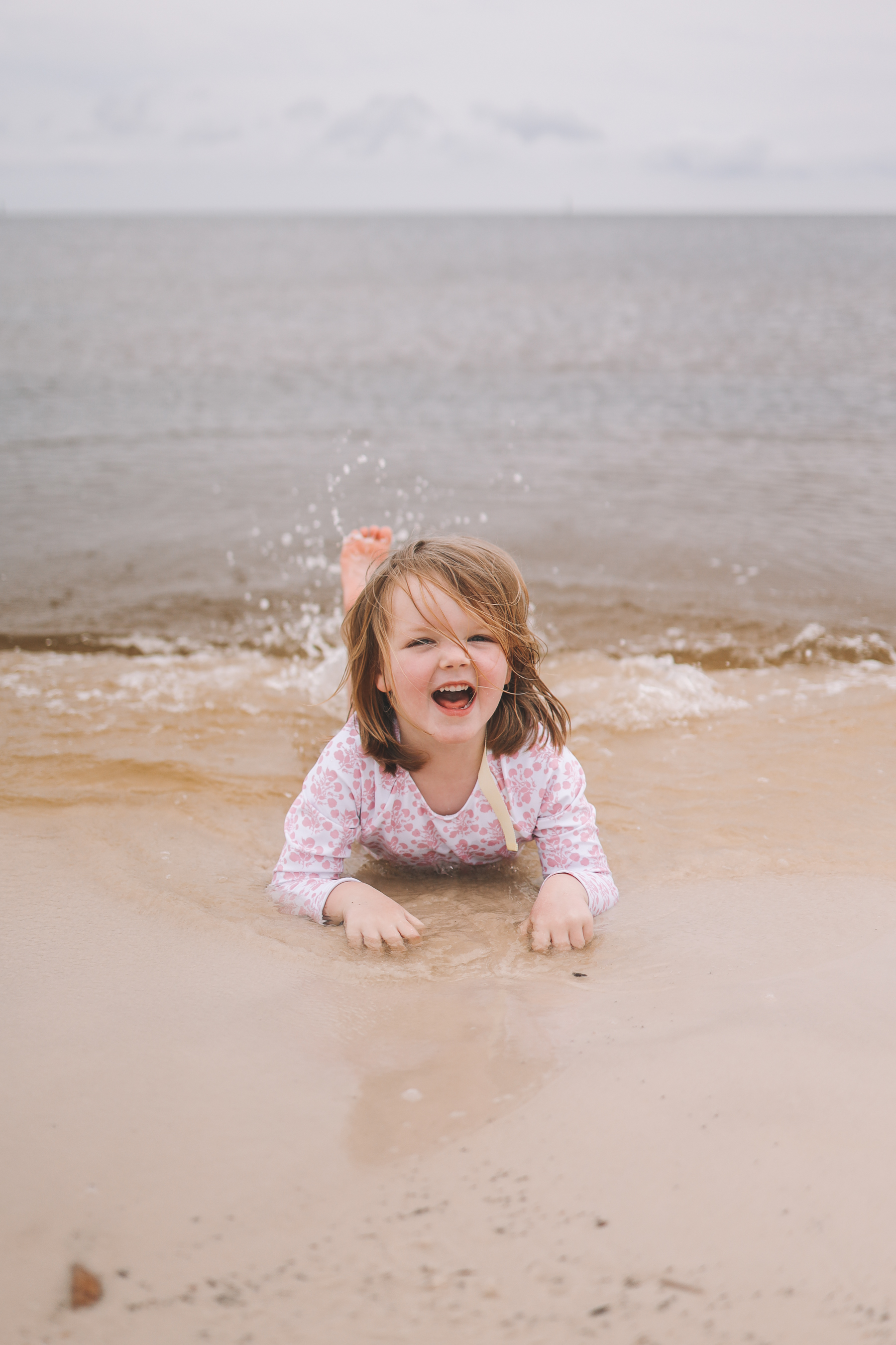 toddler mermaid beach pose