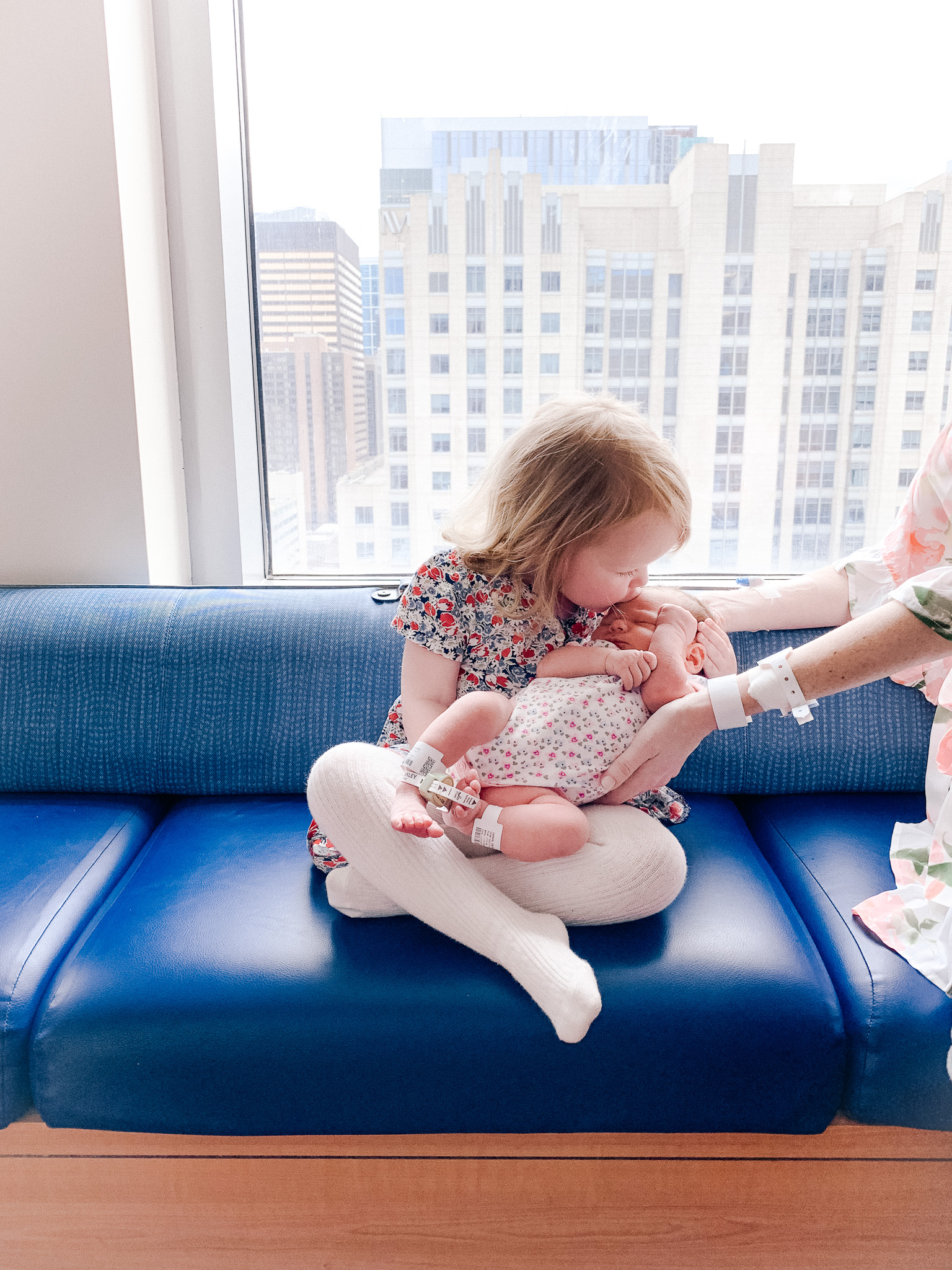 sister holding newborn | Lucys Delivery Story