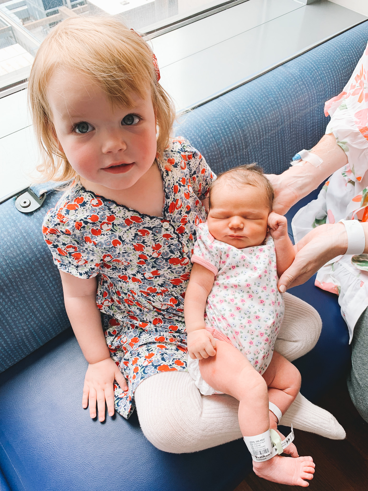 sister holding newborn |Lucys Delivery Story