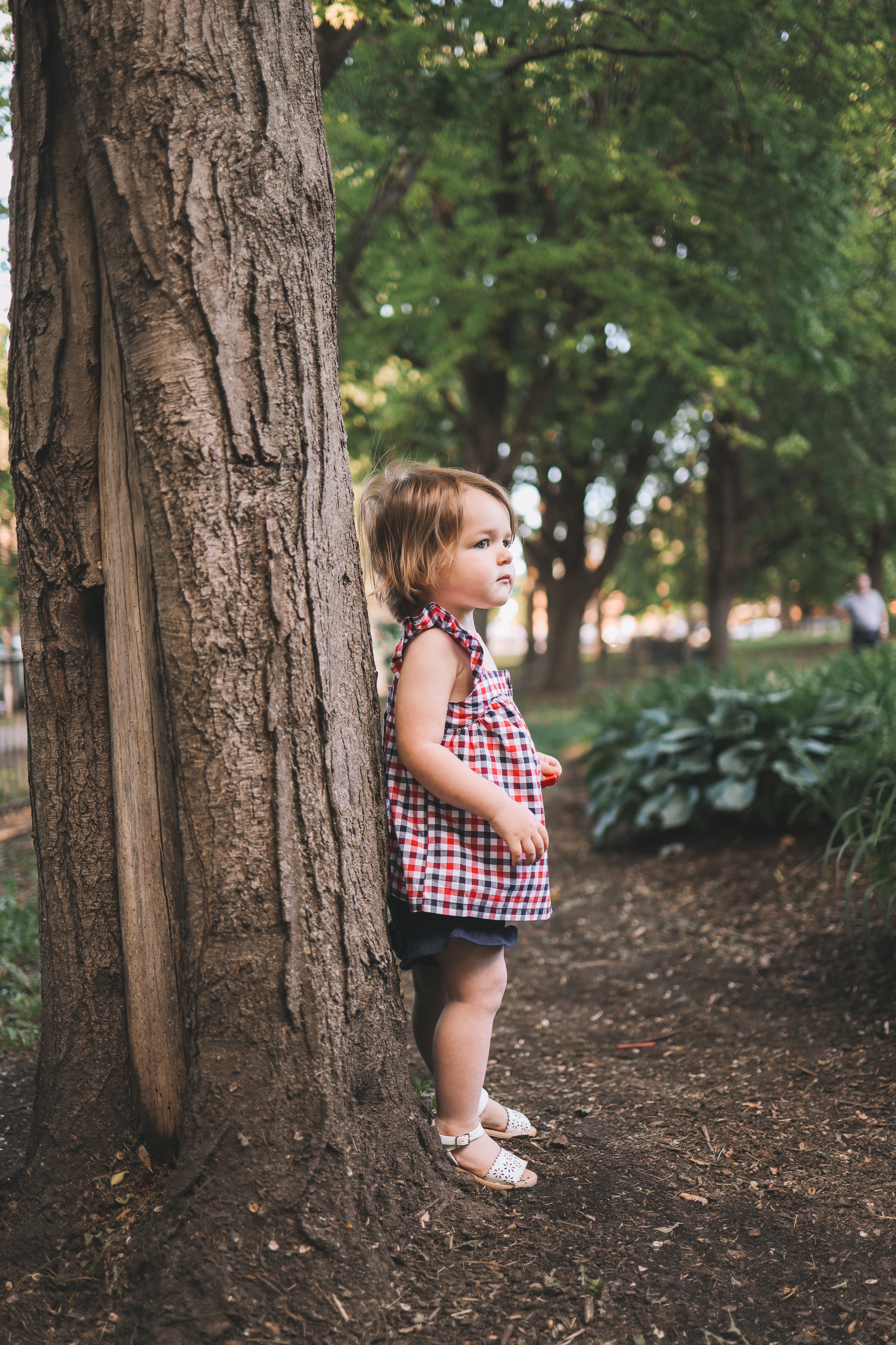 toddler standing by the tree