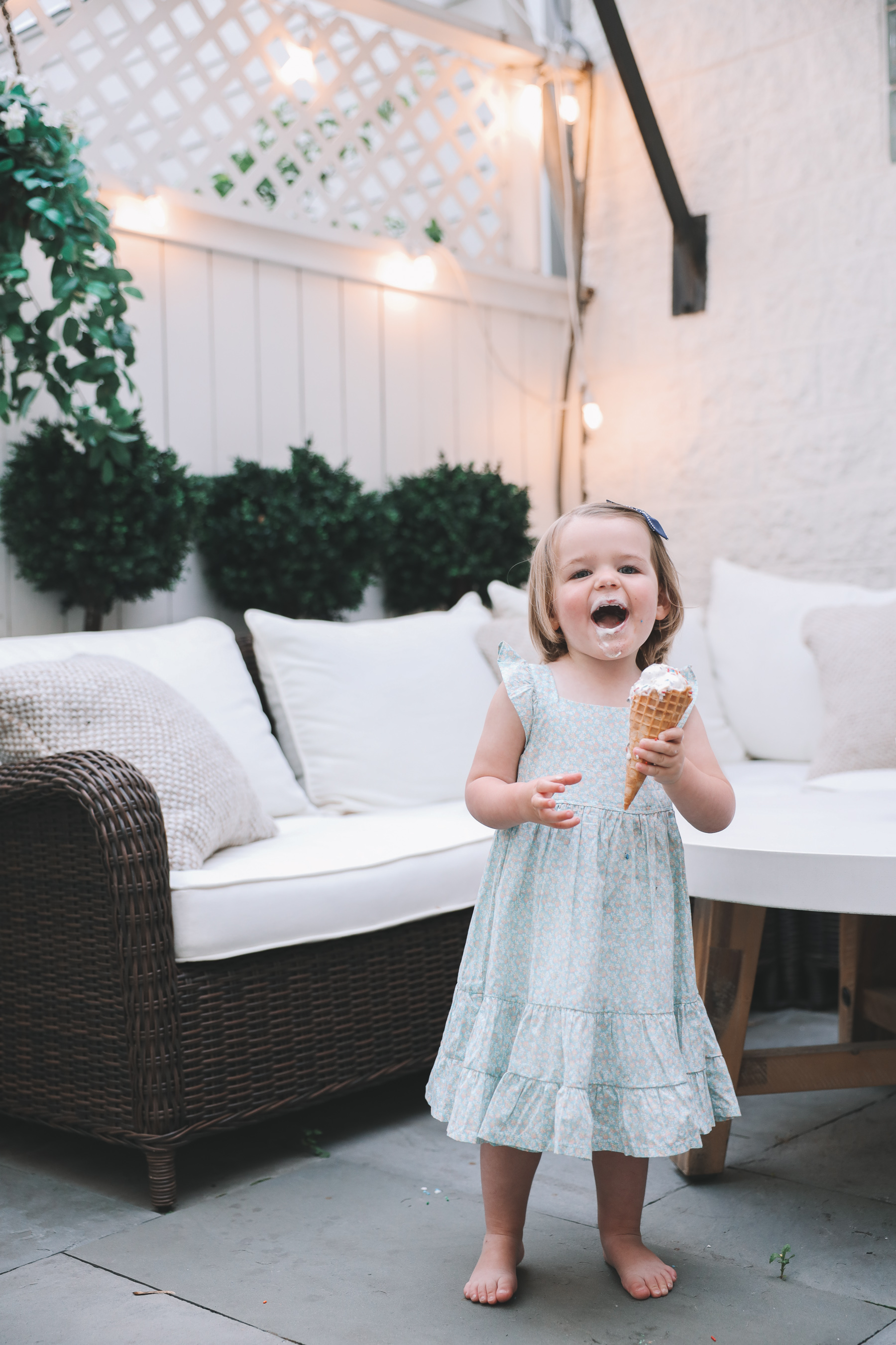toddler eating ice cream all over