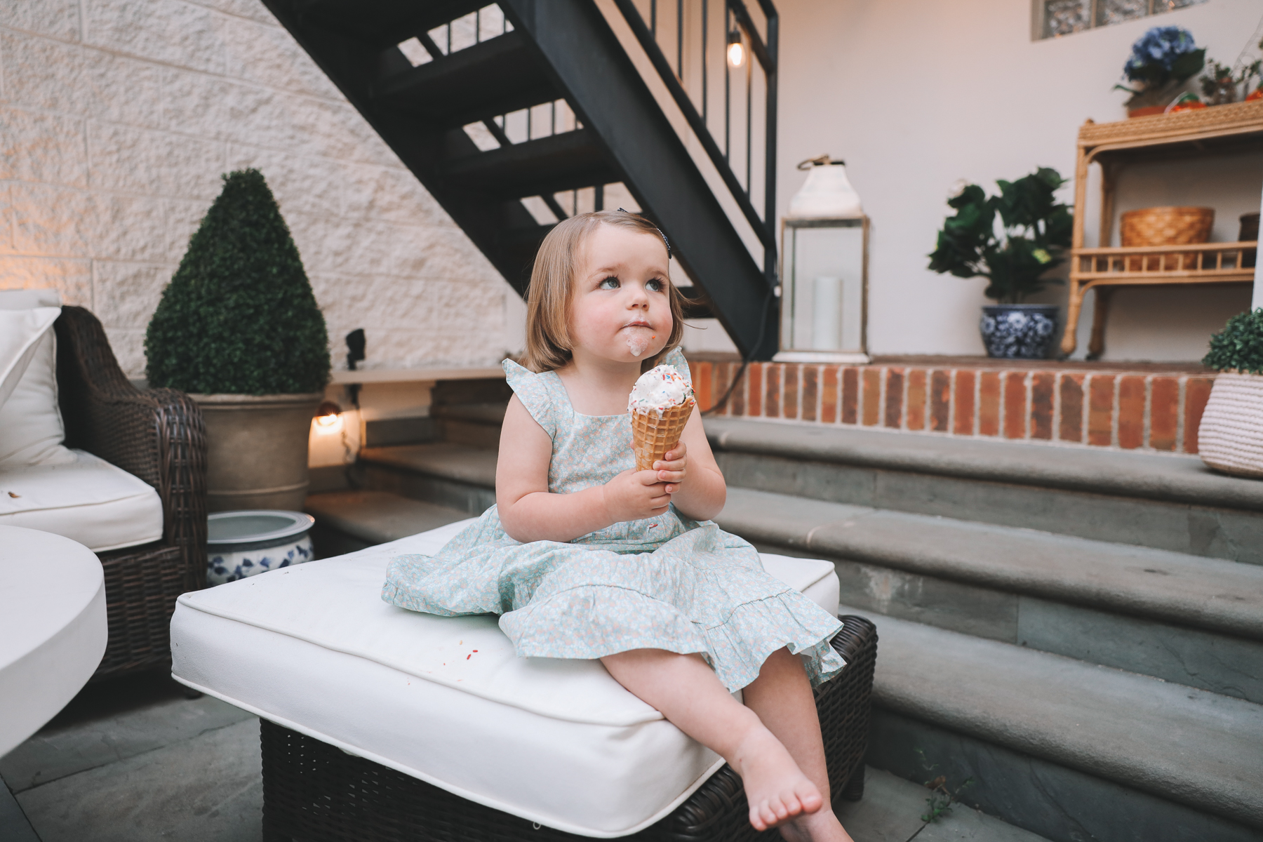 kid with ice cream on her face