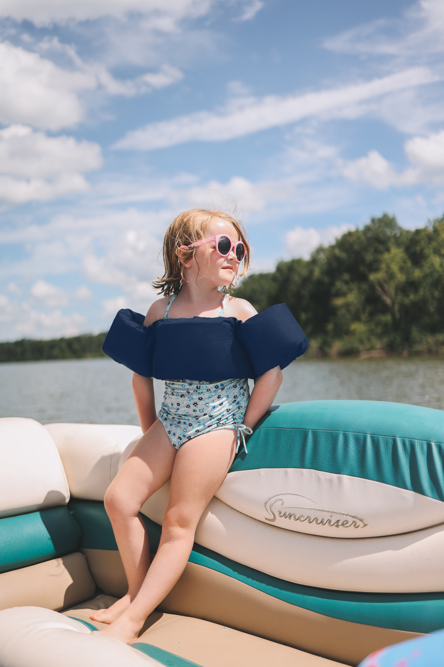 A child with float for swimming