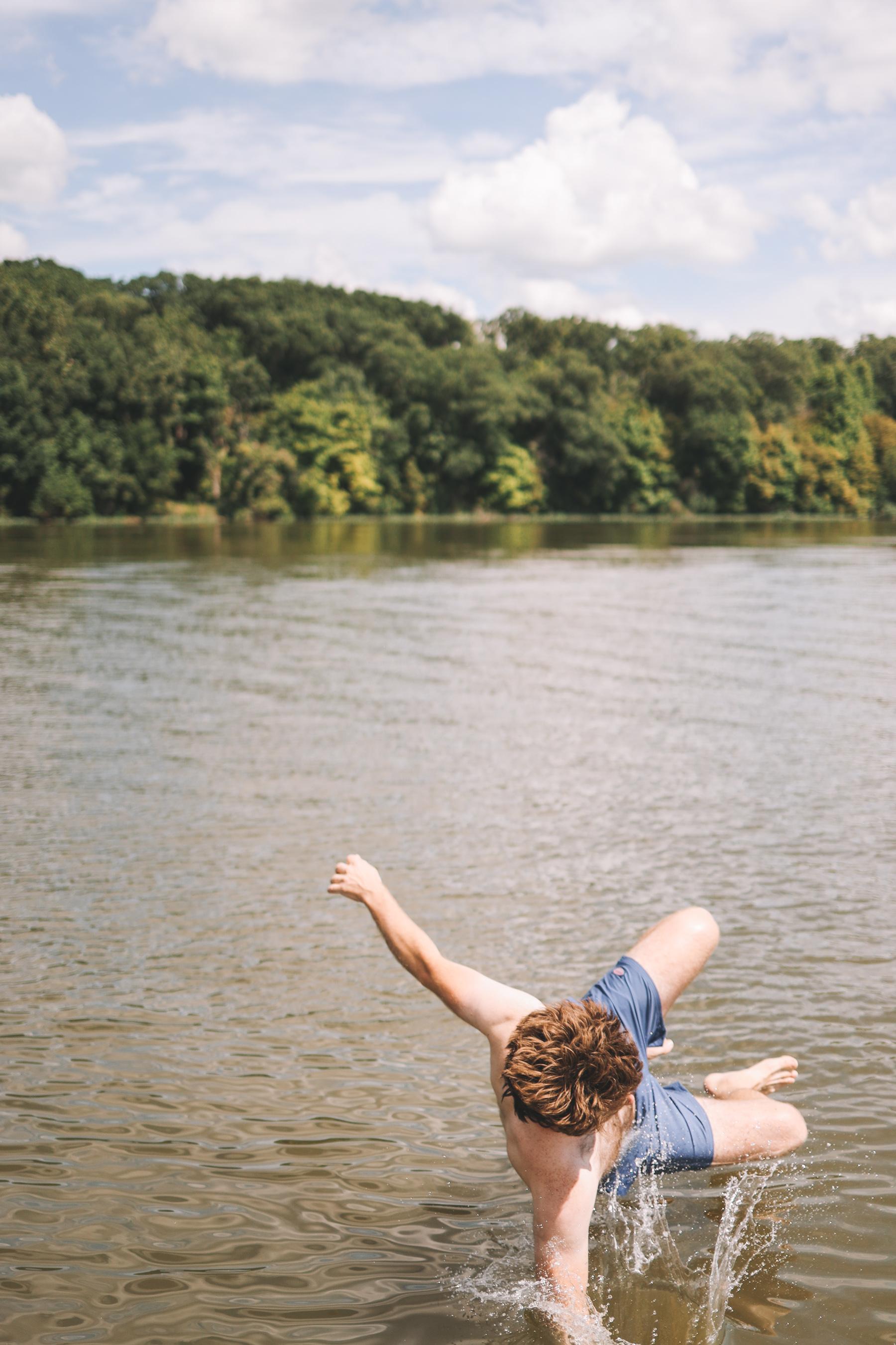 Kid playing in Lake Bloomington