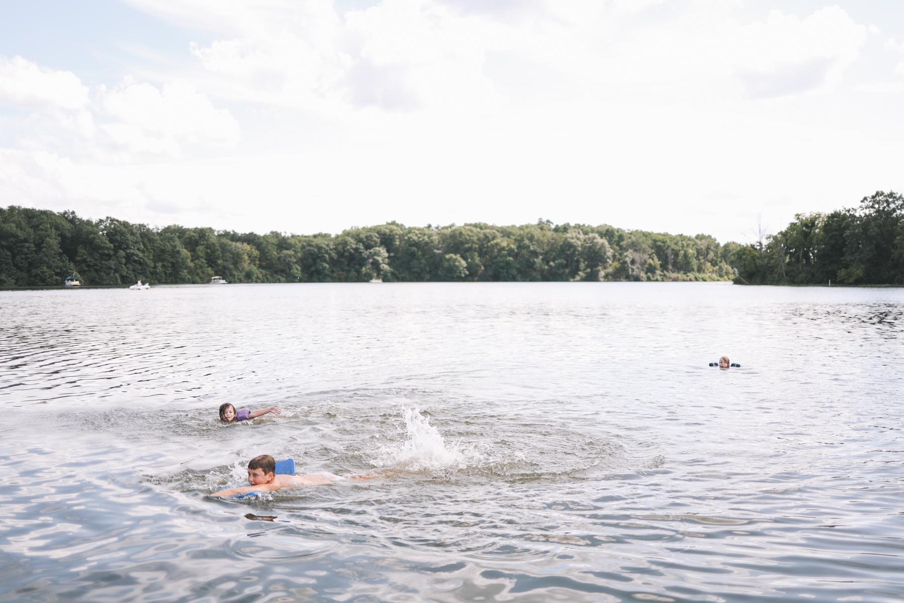 Kids swimming in Lake Bloomington
