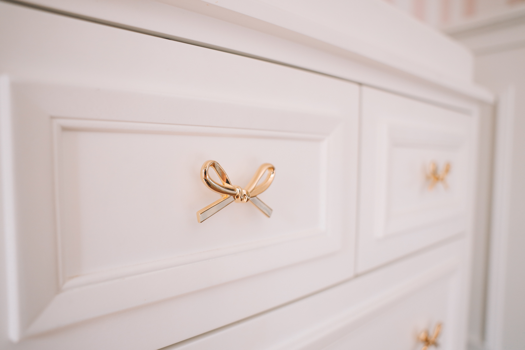 dresser with bow handles