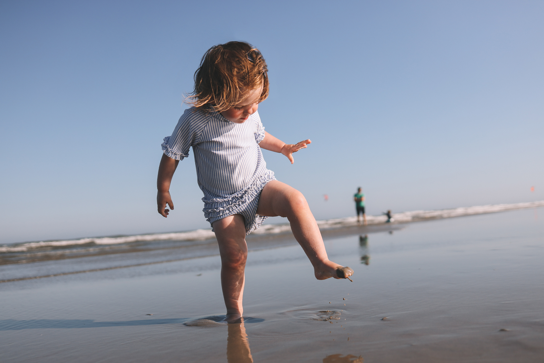 toddler stomping on the sand