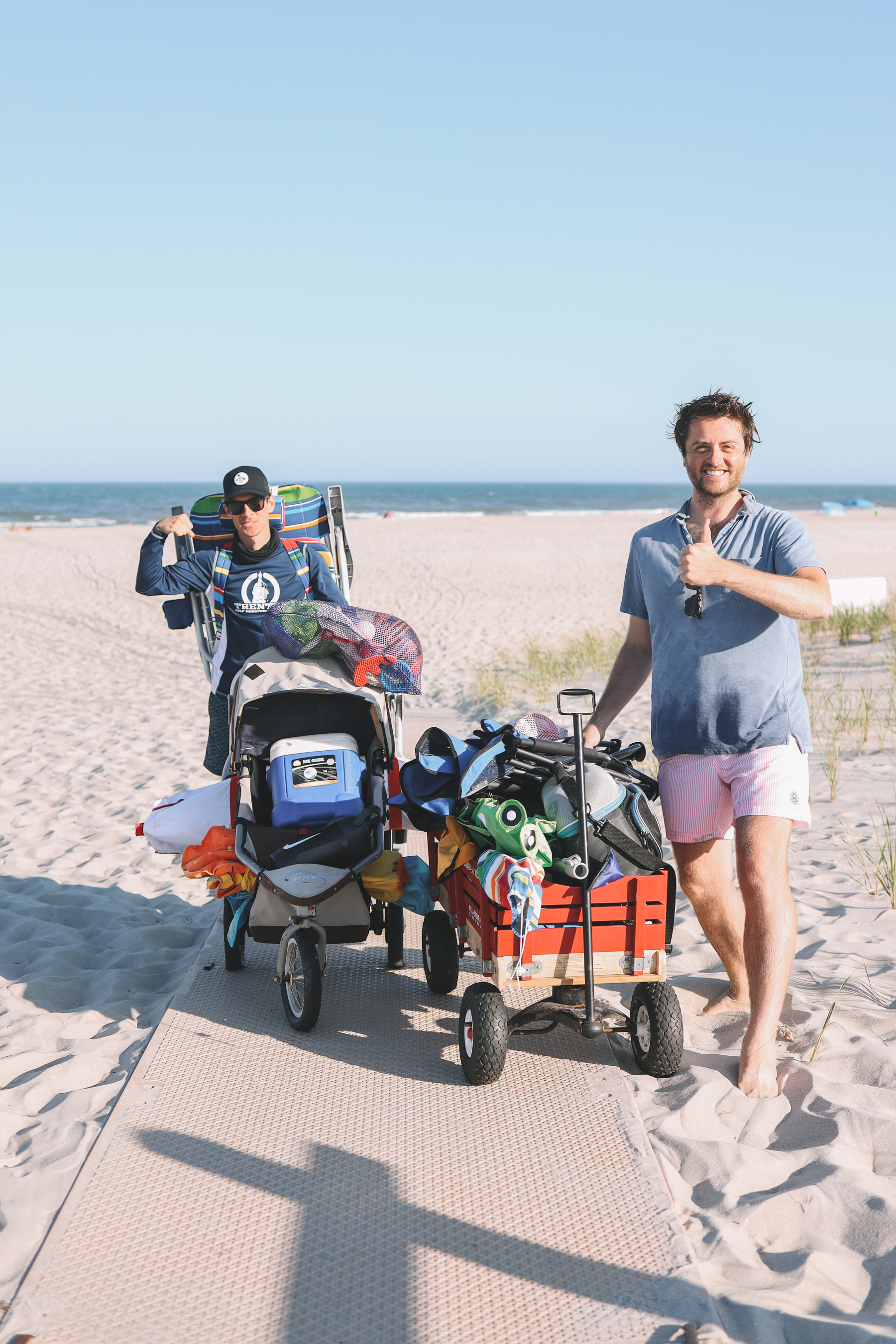 Dads with wagons at the beach